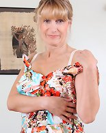 Mature pussy in a floral dress and white lingerie